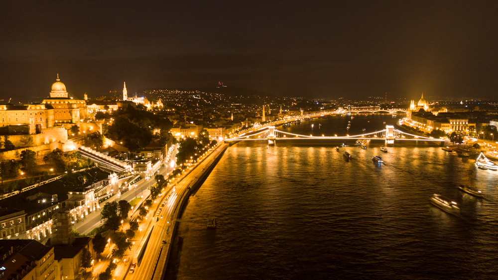 Aerial view of the Danube River and Budapest at night