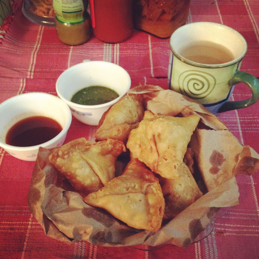 Samosas with tamarind chutney (to the left)