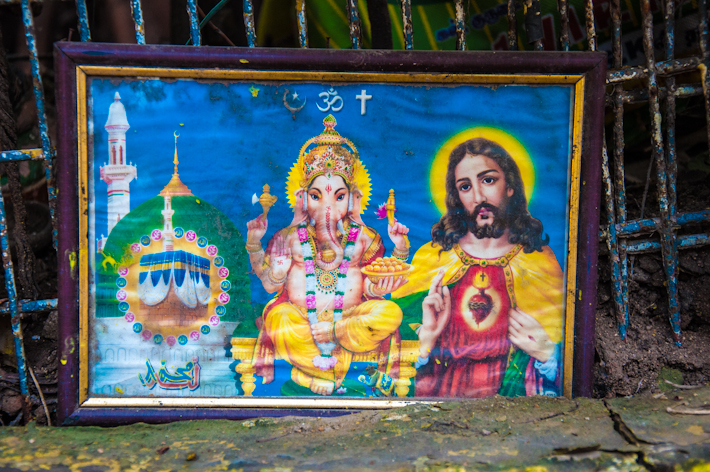 Multi religion symbols at a given street corner in Chennai, India