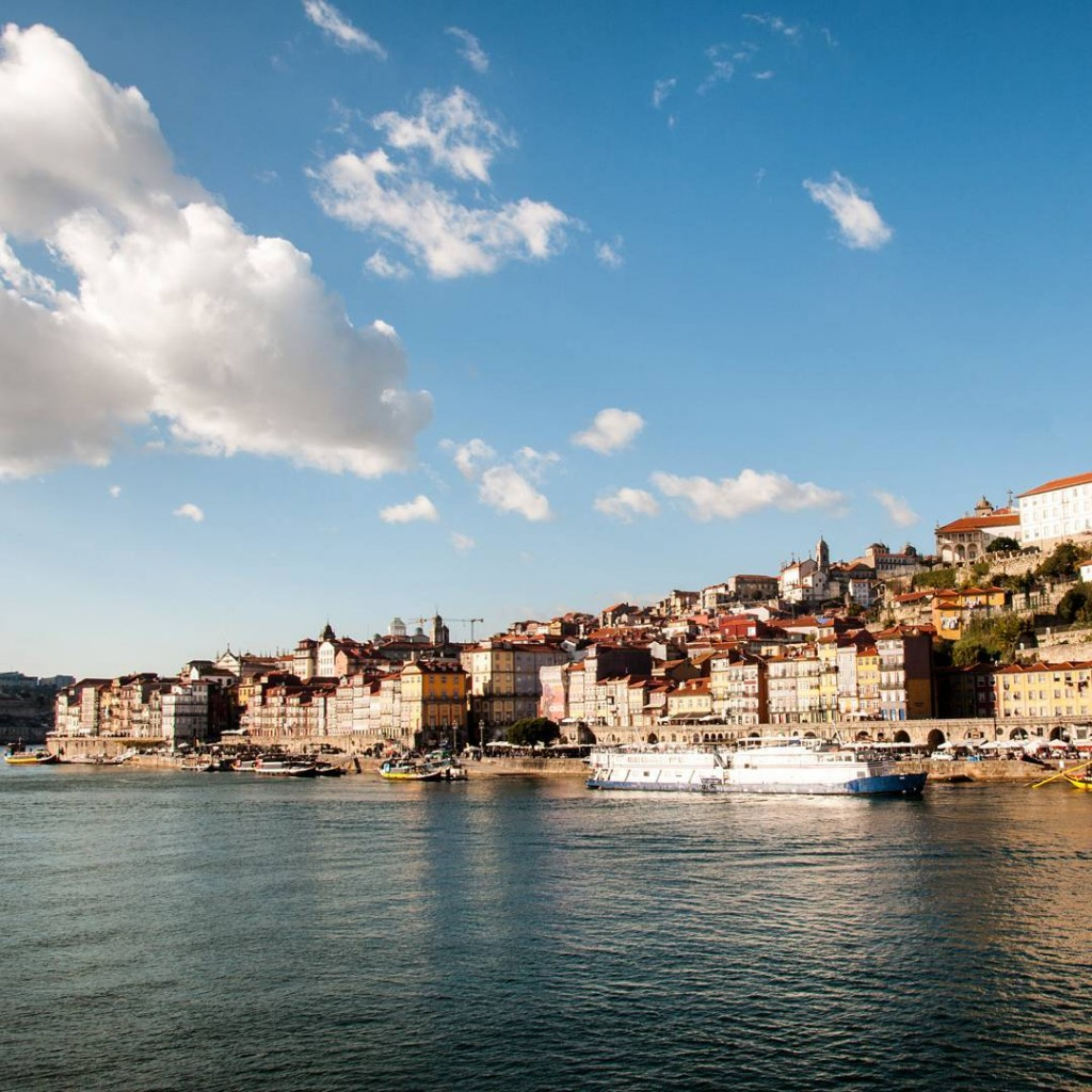 The sun shines over Porto and the Douro River