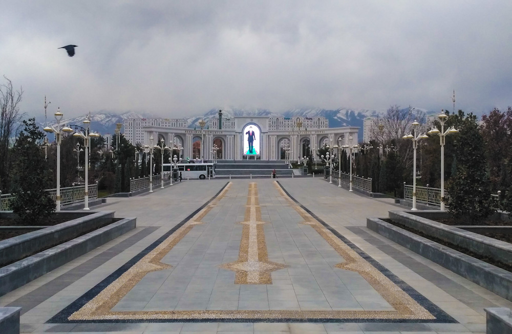 The strange and monumental Ashgabat. That massive neon photo is of the current president. Beyond him you can see the mountains that separate Turkmenistan from Iran.