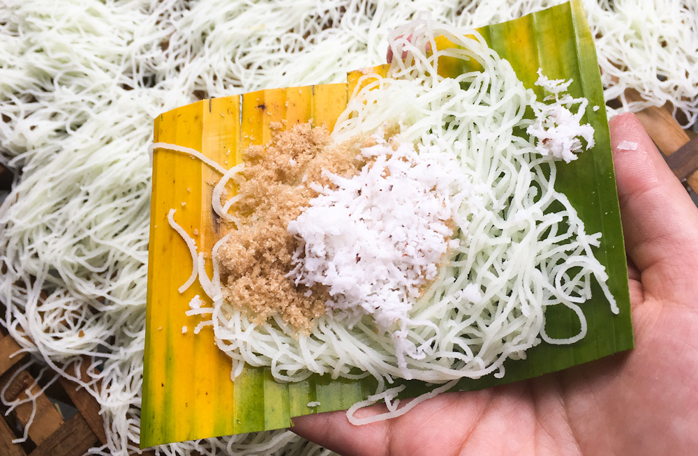 Putu Mayam, shredded rice noodles with grated coconut and palm sugar