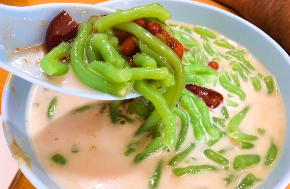 A serving of Cendol that quickly melted away in the heat of Penang