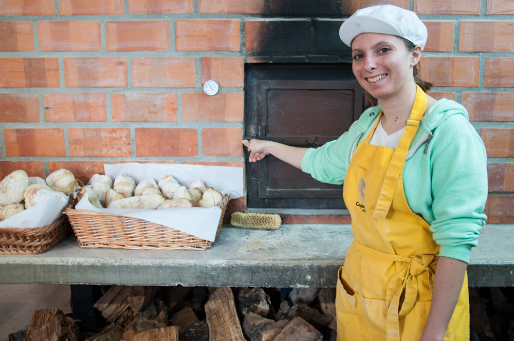 Inside a traditional bakery in Óbidos. This lady was baking Pão com Chouriço, buns stuffed with a kind of Portuguese paprika sausage known as chouriço.