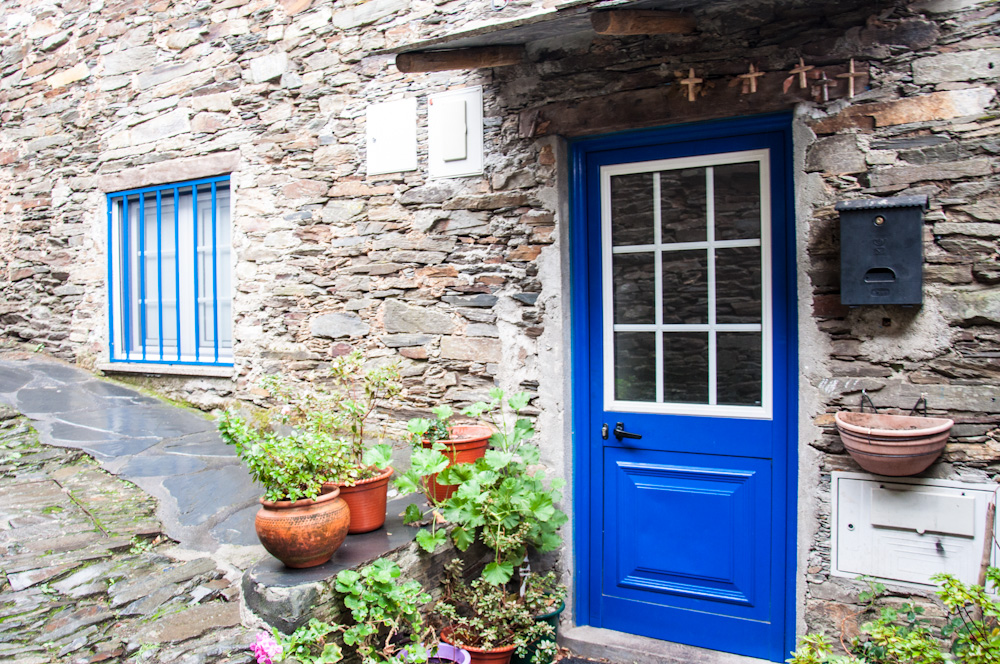 Blue paint contrasts with the dark colors schist stone in the houses of Piódão.