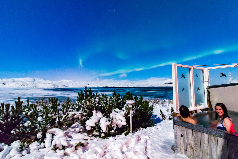 Marveling at the Northern Lights while inside a naturally heated hot tub