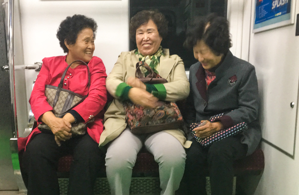 With no mobile device in hand, these three older ladies riding the subway in Seoul were a riot!