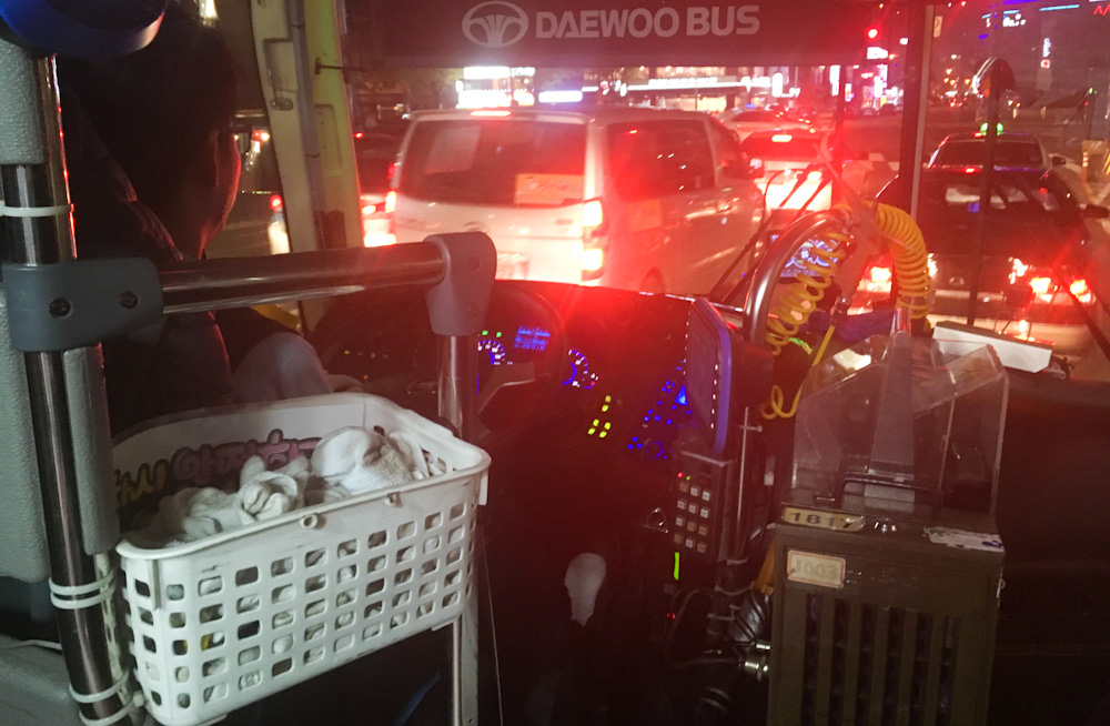 Korean bus drivers wear disposable gloves while driving