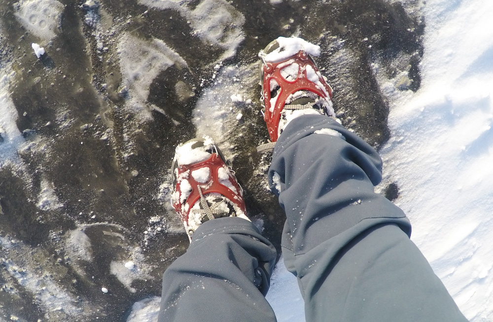 Putting on crampons to walk around Vatnajökull National Park