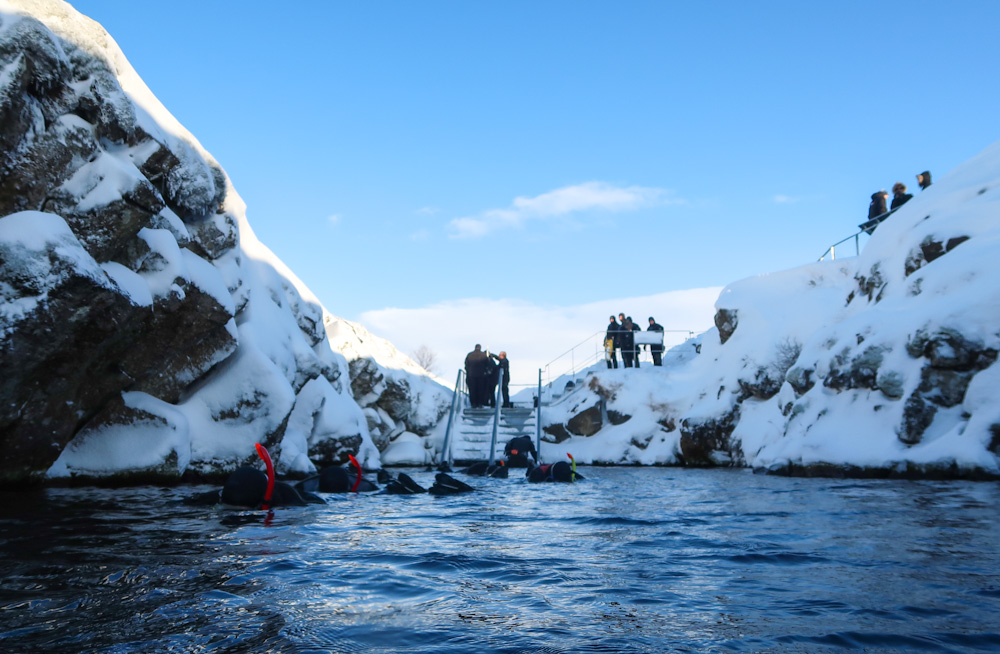 Entering the freezing waters of Silfra